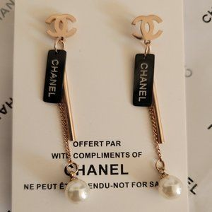 Nw CHANEL rose gold black stainless steel earrings